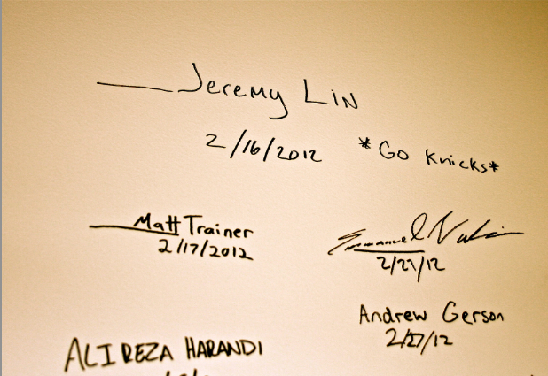 Famous people who visited the headquarters leave their autographs on the wall